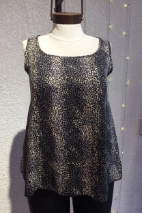 "<a href=""/productosimple/re141fibest/musculosa-fibrana-animal-print"">Musculosa fibrana animal print</a> -"